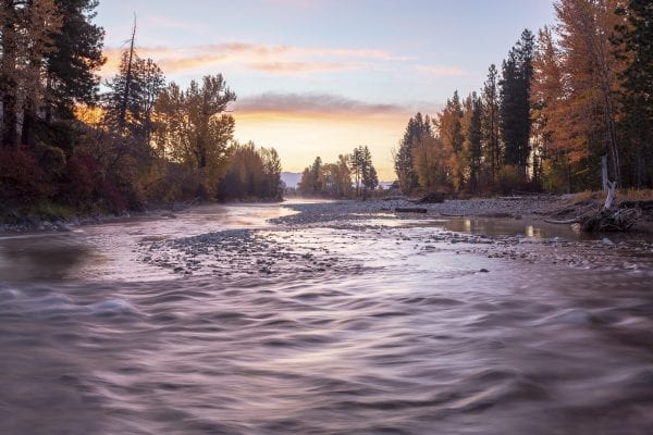 Sunrise on a fall day on the Methow River on the east slope of the North Cascades by the town of Winthrop Washington.